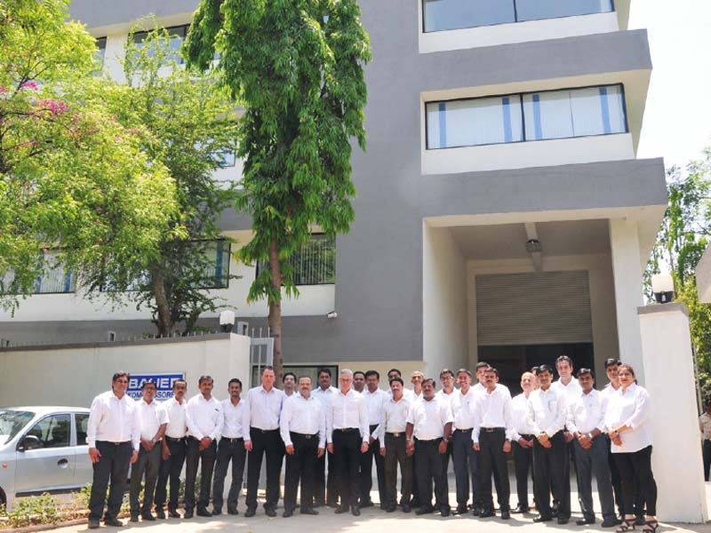 The team celebrate the opening of the new headquarters at Pune with Philipp Bayat (CEO)